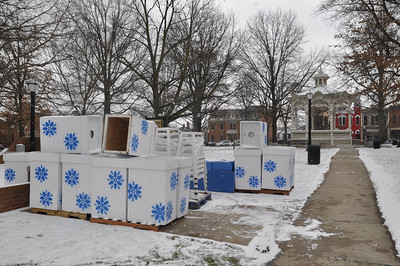 ASHLEY FOX / GAZETTE Crews began setting placements for ice on Thursday ahead of the 23rd Medina Ice Festival that begins today. Blocks of ice will fill the square over the weekend.