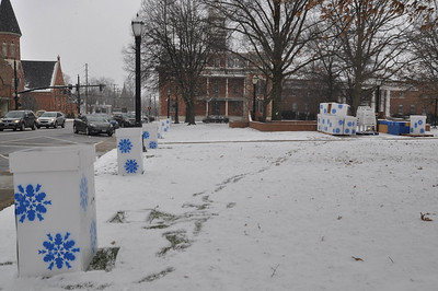 ASHLEY FOX / GAZETTE Thursday was cold and snowy as crews began setting up for the 23rd Medina Ice Festival, a stark contrast to the possible 60-degree-weather forecasters are predicting for the weekend.