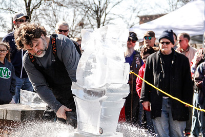 ALEC SMITH / GAZETTE Aaron Costic, a Medina High School graduate and now owner of Elegant Ice Creations in Broadview Heights, works Saturday on ice sculptures at the 23rd Medina Ice Festival on Public Square.