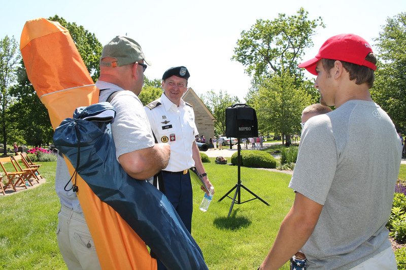 LAWRENCE PANTAGES / GAZETTE U.S. Army retired Col. Ken Dyer of Medina is greeted by well-wishers after his remarks Monday at Spring Grove Cemetery during the city's Memorial Day parade.