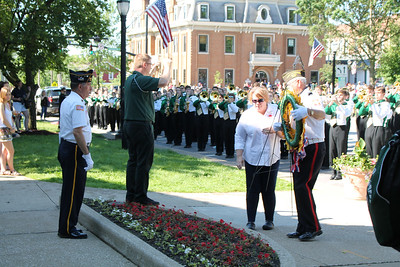 LAWRENCE PANTAGES / GAZETTE Medina County veterans group leader Dave Taylor serves as Commander of the Day for 2017 Memorial Day ceremonies. Before the parade began in front of the Medina County Courthouse, Taylor supervised the placing of a wreath as director Jason Locher conducted the Medina High School marching band.