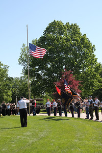 LAWRENCE PANTAGES / GAZETTE Marine Corps League 569 performs the raising of the colors ceremony Monday during the city of Medina's Memorial Day parade that marched from Public Square to Spring Grove Cemetery.