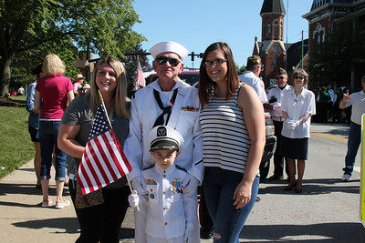 LAWRENCE PANTAGES / GAZETTE Medina VFW Post 5137 Commander Scotty Kopfstein gets ready for the city of Medina's Memorial Day parade with family members, from left: granddaughter Kierra Dormendo, her son Mason Dormendo, age 5, and granddaughter Sarayah Kress. Mason is Kopfstein's great grandson.