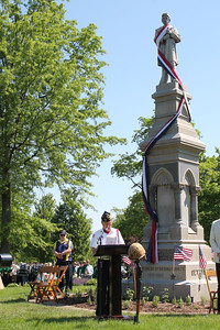 LAWRENCE PANTAGES / GAZETTE Medina Veterans Commander of the Day Dave Taylor speaks Monday during Memorial Day ceremonies at Spring Grove Cemetery.