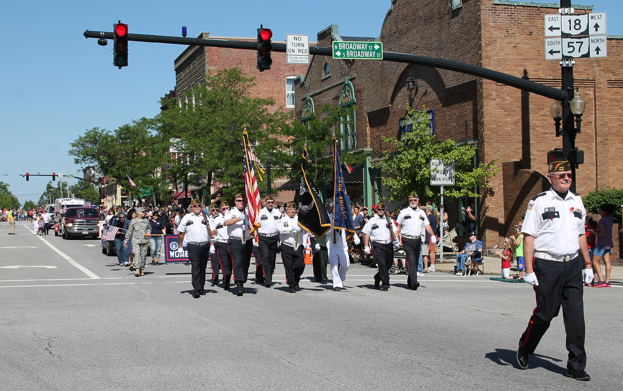 LAWRENCE PANTAGES / GAZETTE Marine Corps League 569 carries the colors around Public Square on Monday during the city of Medina's 2017 Memorial Day parade that led to Spring Grove Cemetery.