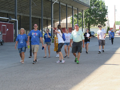 LYDIA MAINZER / SPECIAL TO THE GAZETTE  Medina Relay for Life participants walk their final lap for the 2017 Relay for Life Event. Officials said the fundraiser held at the Medina County Fairgrounds brought in more than $95,000 for the American Cancer Society.