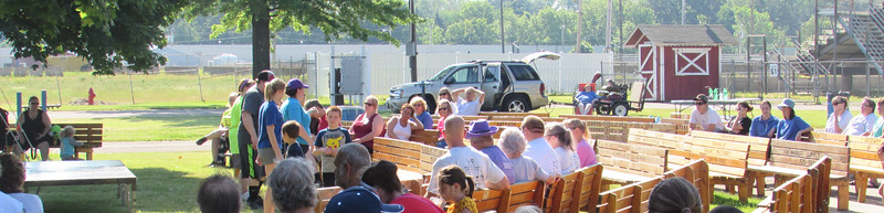 LYDIA MAINZER / SPECIAL TO THE GAZETTE  Medina Relay for Life participants gather for a closing ceremony Saturday. Officials said the fundraiser held at the Medina County Fairgrounds brought in more than $95,000 for the American Cancer Society.