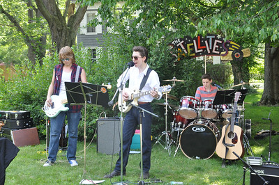 ASHLEY FOX / GAZETTE Pictured left to right are Highland School District students Nick Edgar, Delsin Ross and Garret Ross, members of The Super Satellites. The trio performed during Rockin' the Court Saturday.