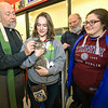 From the left: Rev. Ted Estes, of Grace Church in Carthage, Faith Escobar, of Pneuma at Missouri Southern, Dr. Jim Lile, of All Saints' Church in Nevada and Madi Kyger, of MSSU's Pneuma, gather for a blessing of the pets on Wednesday at Petsmart. Additional blessings are planned throughout the area, including the Joplin Humane Society.<br /> Globe | Laurie Sisk