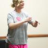 Lisa Paugh joins in on the fun during Freeman's Party in Pink Zumba event on Tuesday at the Freeman Business Center. The event was to show support for breast cancer patients and survivors.<br /> Globe | Laurie Sisk
