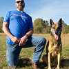 """Takoa,"" a retired Belgian Malinois K-9 officer, poses with retired Joplin Police Department Officer Travis Wathall near Goodman on Wednesday.<br /> Globe 