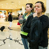 Irelys Martinez, right, and her daughter, Syleris Gwin Martinez anxiously await the arrival of Irelys' parents from Puerto Rico on Tuesday morning at the Springfield-Branson National Airport.<br /> Globe | Laurie Sisk