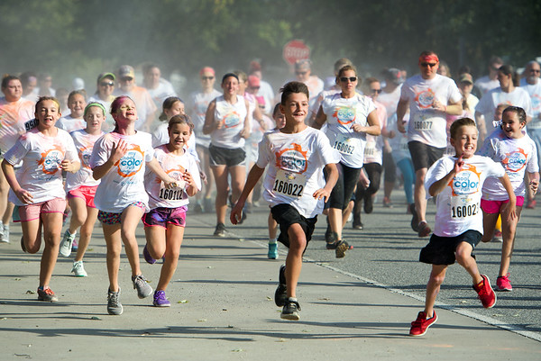 Participants make their way along the start of the course during Central Elementary's My School Color Run on Saturday in Baxter Springs.<br /> Globe | Laurie Sisk