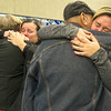 From the left: Irelys Martinez hugs her mother, Oraida Muñoz, while Syleris Gwin Martinez embraces her grandfather, Raul Martinez, upon their arrival from Puerto Rico on Tuesday morning at the Springfield-Branson National Airport. The couple will make Joplin their temporary home while their island recovers from Hurricane Maria.<br /> Globe | Laurie Sisk