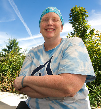 Breast cancer patient Tammy Aggus sits outside the Mercy Cancer Center on Thursday.<br /> Globe  | Laurie Sisk