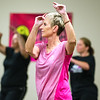 Dot Nicolas dances during Freeman's Party in Pink Zumba event on Tuesday at the Freeman Business Center. The event was to show support for breast cancer patients and survivors.<br /> Globe | Laurie Sisk
