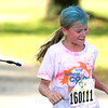 Baxter Springs Central Elementary fourth grader Mazie Merriman reacts as she is sprayed with color during her school's My School Color Run on Saturday at the school.<br /> Globe | Laurie Sisk