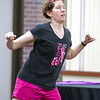 Christina Stotts moves to the music during Freeman's Party in Pink Zumba event on Tuesday at the Freeman Business Center. The event was to show support for breast cancer patients and survivors.<br /> Globe | Laurie Sisk
