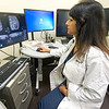 Dr. Sonu Sury, medical direcror at the Mercy Breast Center, looks at a scan of a patient's breasts at Mercy Joplin.<br /> Globe | Laurie Sisk