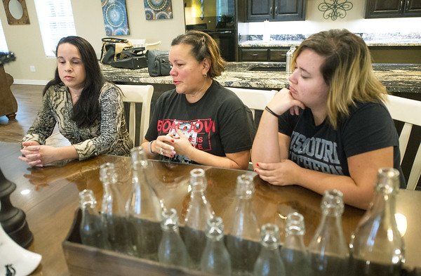 From the left: Joplinites Aura Caban, Irelys Martinez and her daughter, Syleris Martinez, share their concerns over loved ones still in Puerto Rico during an interview last week at Cooper's Point Landing.<br /> Globe | Laurie Sisk