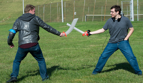 From the left: Missouri Southern student James Walls and Joplin resident Alex Eden do battle with foam rubber swords during a fundraiser for MSSU's Sakura Otaku Squad, a club promoting the appreciation of Japanese pop culture. The group is also planning to host a public Mourning Moon Masquerade Ball on Nov. 14 at MSSU.<br /> Globe | Laurie Sisk