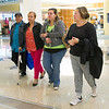 From the left: After an emotional greeting, Raul Martinez and Oraida Muñoz depart the Springfield-Branson National Airport with their granddaughter, Syleris Gwin Martinez and daughter Irelys Martinez as they prepare to make Joplin their temporary home while their island of Puerto Rico recovers from Hurricane Maria.<br /> Globe | Laurie Sisk