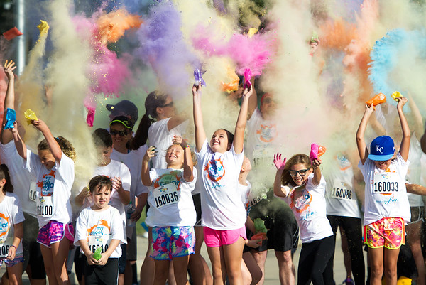 Participants release colorful packets of powder before the start of their My School Color Run on Saturday at Central Elementary in Baxter Springs.<br /> Globe | Laurie Sisk