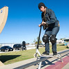 Professional flatlander George Eklund jumps a rail on Tuesday at the Ewert Skate Park. Temperatures in the lower 70s brought skaters out in droves on Tuesday.<br /> Globe | Laurie Sisk