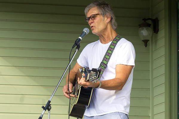 Joey Pogue entertains guests on Saturday at 601 N. Moffett during the North Heights Neighborhood Group's Porchfest. The event featured acts performing on neighborhood porches, food, children's activities and more.<br /> Globe | Laurie Sisk