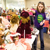 From the left: Emily Barnhart, 11 and Emory Workman, 6, take time out from their Neosho Girl Scout Troop 70098 booth to check out a collection of dolls during Joplin's Biggest Indoor Yard Sale, sponsored by The Joplin Globe on Saturday at The Jack Lawton Webb Convention Center. The troop hopes to raise $1,500 to purchase a handicapped swing for Neosho parks.<br /> Globe | Laurie Sisk