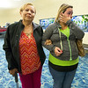 Syleris Gwin Martinez wipes a tear as she walks arm-in-arm with her grandmother, Oraida Martinez upon Oraida's arrival from Puerto Rico on Tuesday morning at the Springfield-Branson National Airport.<br /> Globe | Laurie Sisk