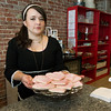 Kristen Sheafer, owner of Frosted Cakerie, 124 S. Main St., displays a tray of the heart-shaped, pink cookies she is selling for Breast Cancer Awareness Month. Sheafer is donating $1 for each cookie sold to the Mercy Health Foundation Mammogram Fund.<br /> Globe | Laurie Sisk
