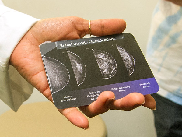Dr. Sonu Sury, medical direcror at the Mercy Breast Center, holds a card classifying breats by their densities at Mercy Joplin.<br /> Globe | Laurie Sisk
