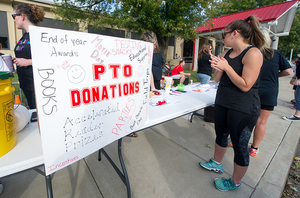 Baxter Springs Central Elementary PTO works to augment fundraising at their My School Color Run on Saturday at the school.<br /> Globe | Laurie Sisk