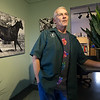 "Flanked by his acrylic piece, ""A Study in Black and White,""  Veterinarian and artist Michael Gory reflects on his development as an artist on Tuesday at his College View Veterinary Clinic<br /> Globe 