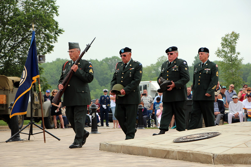HALEE HEIRONIMUS / GAZETTE Members of the 555th Honors Detachment march to the front of the podium assemble the Soldier's Cross, which contains a rifle, helmet and boots. The presentation was part of the Ohio Western Reserve National Cemetery's Memorial Day program Sunday afternoon.