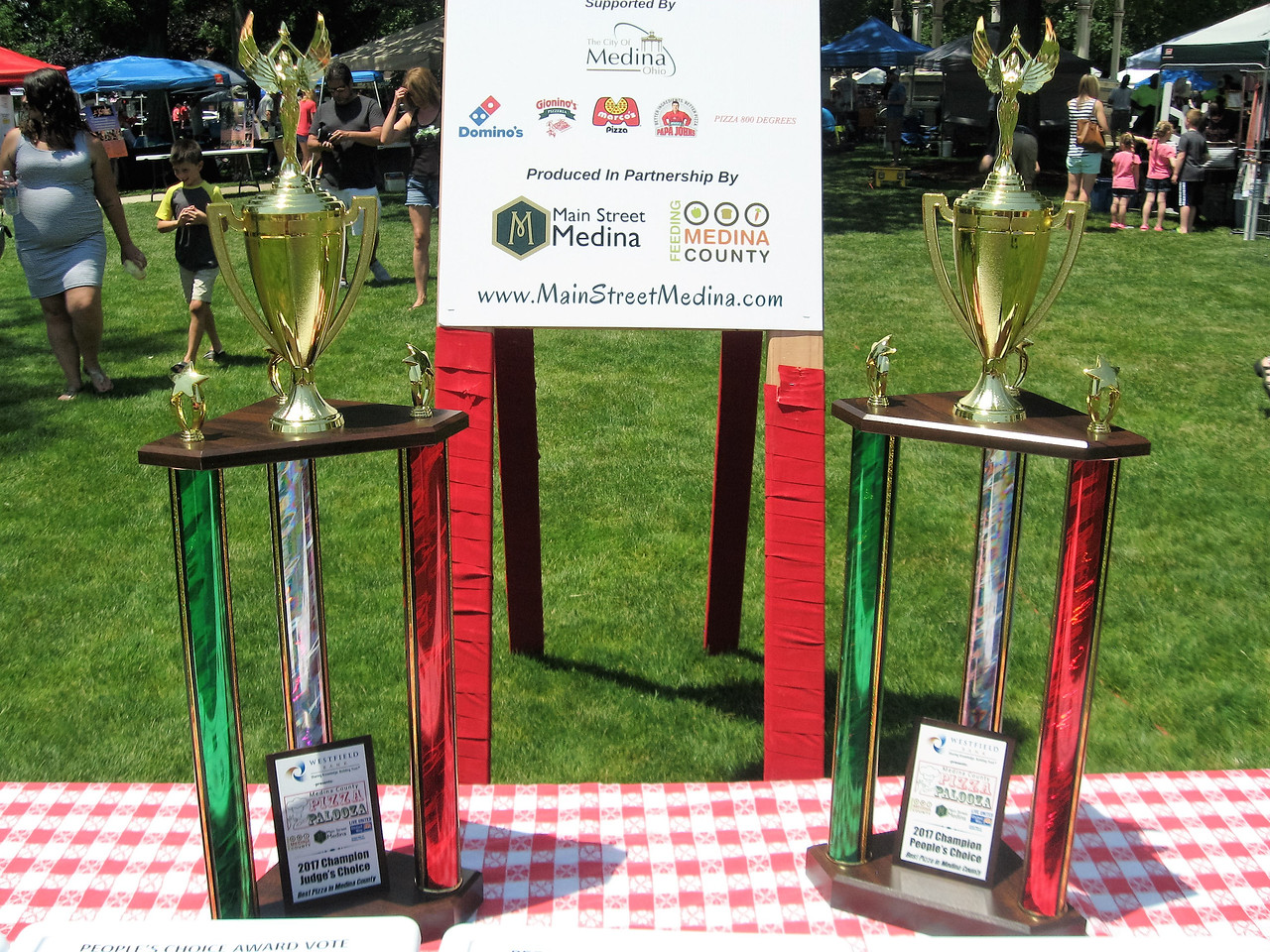 BOB SANDRICK / GAZETTE Five local pizzerias vied for the judges' trophy and the people's-choice trophy Saturday at Pizza Palooza in Medina.