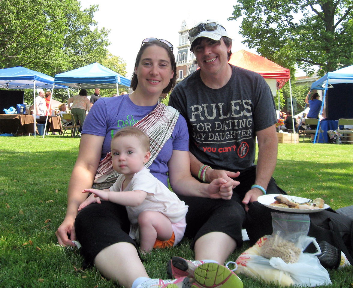 BOB SANDRICK / GAZETTE Scott Palasik of Medina, with his wife Megan and 1-year-old daughter Karis, celebrated Father's Day weekend Saturday at Pizza Palooza on Public Square.