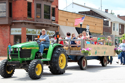 HALEE HEIRONIMUS / GAZETTE The Guilford Township Gofers 4-H Club rides in a tractor trailer during the Memorial Day parade in Seville Monday afternoon.
