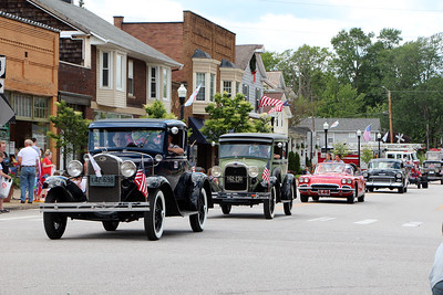 HALEE HEIRONIMUS / GAZETTE Old vehicles paraded down Main Street in Seville Monday afternoon as part of the Memorial Day parade.