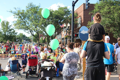 LUCAS FORTNEY / GAZETTE Spectators wait patiently Tuesday evening for the beginning of the Blue Tip Festival parade in Wadsworth. The event began late, which prompted attendees along the streets to say they have always waited in the event's 44 years.