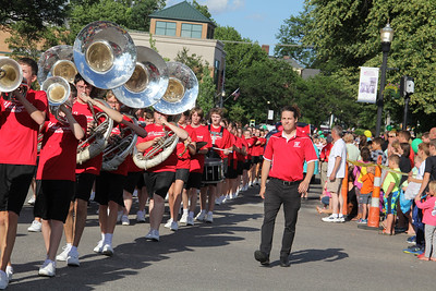 ALEC SMITH / GAZETTE Wadsworth High School assistant band director Sam Piehl accompanies the Grizzly marching band Wednesday during the Blue Tip Festival parade held through the streets of Wadsworth.