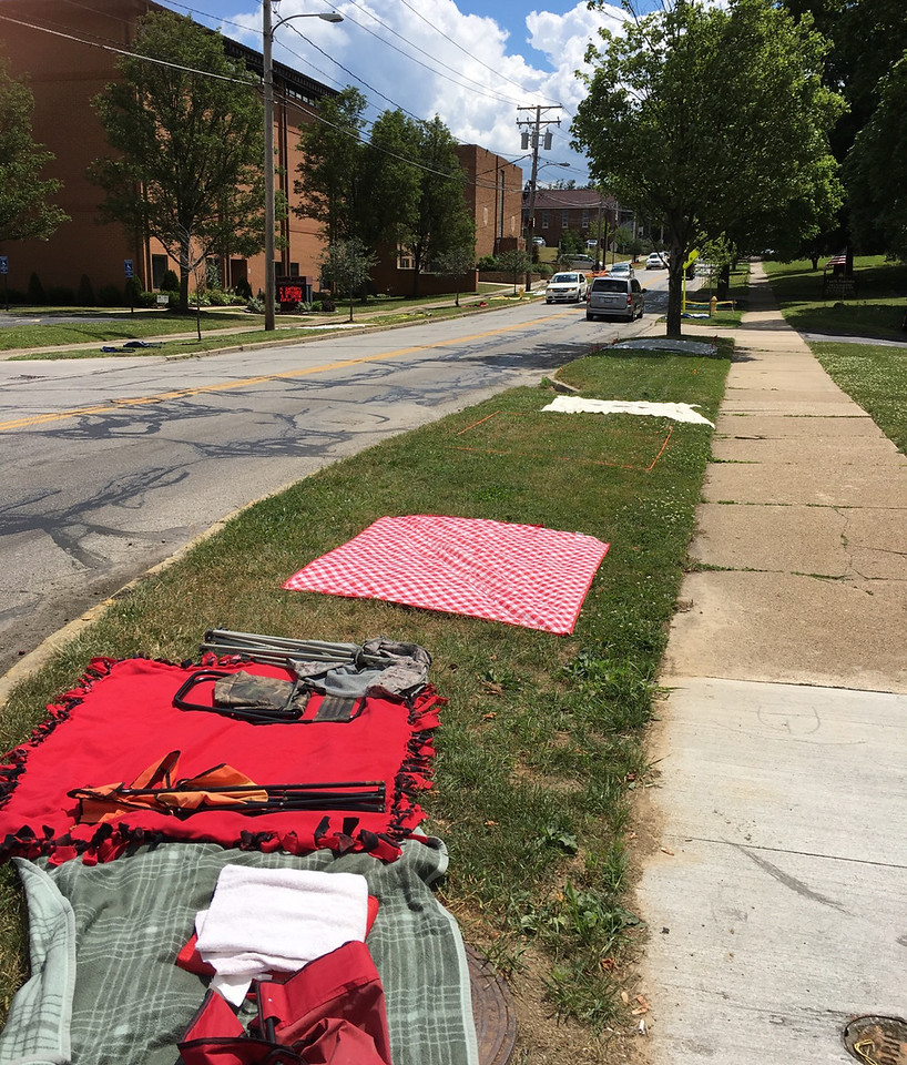 ASHLEY FOX / GAZETTE Sections of tree lawns along Broad Street in Wadsworth have been claimed by parade enthusiasts a day before the 44th Annual Blue Tip Parade tonight at 6 p.m.