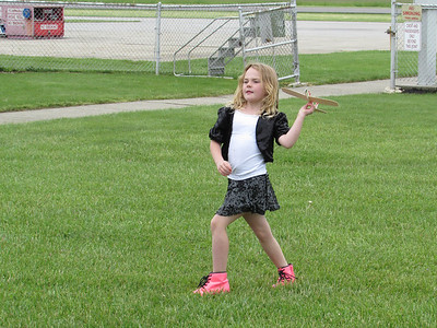 LYDIA MAINZER / GAZETTE Olivia Wapenaar, 7, of Wadsworth, flying her own balsa wood airplane provided by the local EAA chapter.