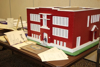 HALEE HEIRONIMUS / GAZETTE  A replica of the brick building of what was York High School from 1922 to 1953 was on display among other scrapbooks Friday evening at the 110th York High School Alumni Association banquet.