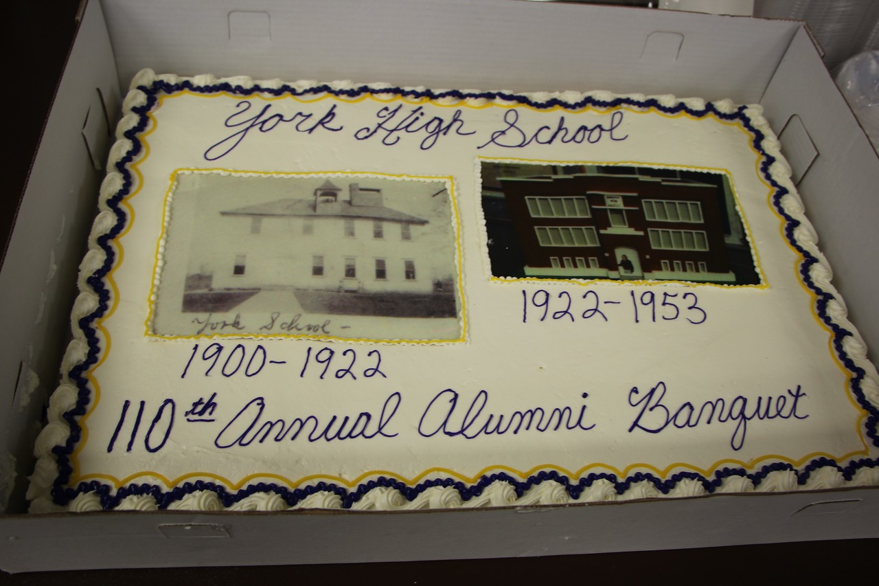 HALEE HEIRONIMUS / GAZETTE A cake shows a picture of the original York High School in 1900 to 1922 and the brick building of York High School from 1922 to 1953.