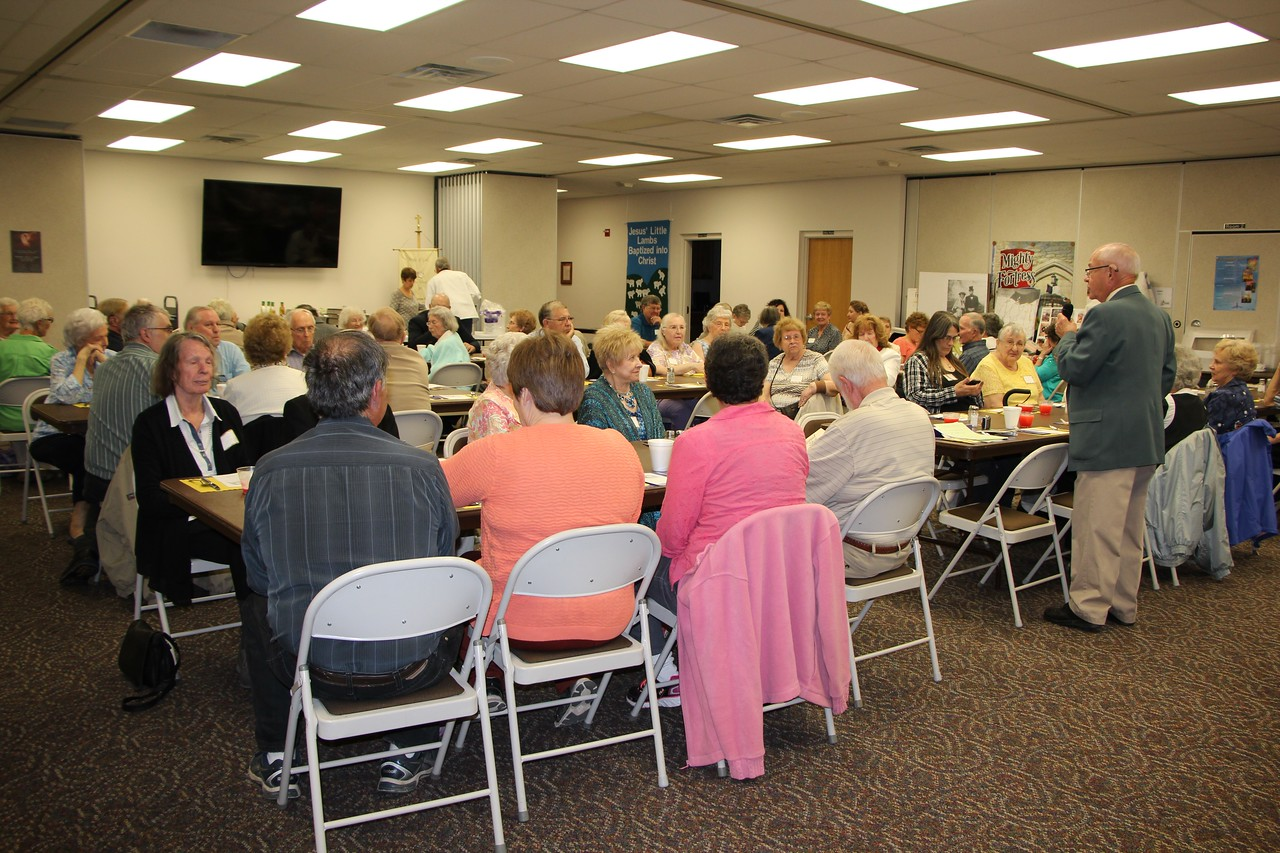 HALEE HEIRONIMUS / GAZETTE  York High School Alumni Association President Bill Schultz welcomes a crowd of about 74 alumni and their family Friday evening to the banquet at St. Paul Evangelical Lutheran Church, 1377 Lester Road, Liverpool Township.