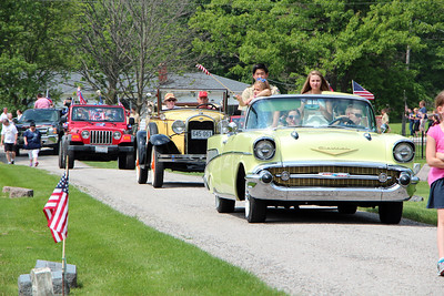 HALEE HEIRONIMUS / GAZETTE A 1957 Chevrolet Bel Air leads a group of vehicles into the York Township Cemetery on Norwalk Road to conclude the Memorial Day parade Sunday afternoon.