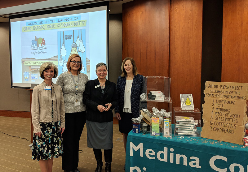 CINDY BREDA / GAZETTE Medina County District Library and United Way of Medina County on Tuesday launch this year's One Book, One Community program. From left, Mary Olson, district library's readers' advisory librarian; with Aimee Adams, district library events coordinator; CEO Cheryl Parzych of United Way of Medina County; and Carole Kowell, executive director of the district library.