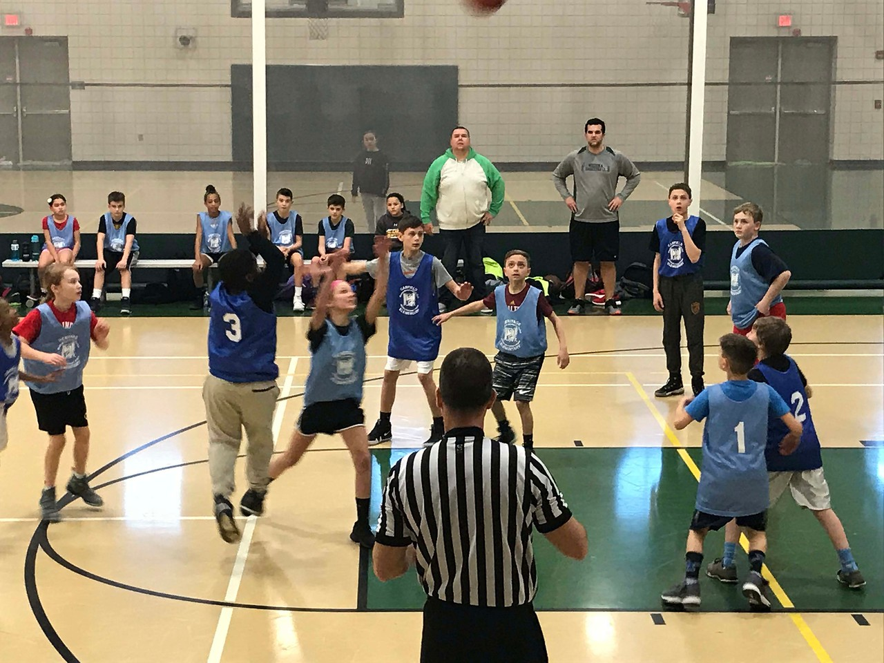 NATHAN HAVENNER / GAZETTE  Fifth-graders from Medina Schools' Heritage Elementary and Garfield Elementary compete Thursday in the Medina County Police Activities League March Madness Basketball Tournament at Medina Community Recreation Center.